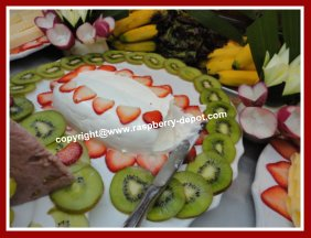 A cheese tray decorated with fruit
