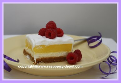 Creamy Lemon Dessert Squares with Fresh Raspberries on Top