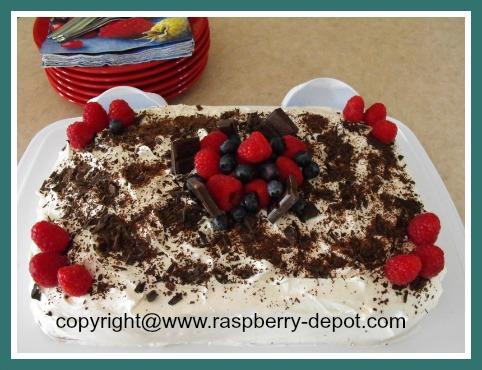 Easy Raspberry Cake Recipe with Raspberries on Top
