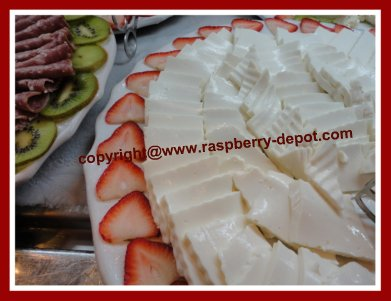 Decorating a Cheese Tray by Garnishing it with fruit