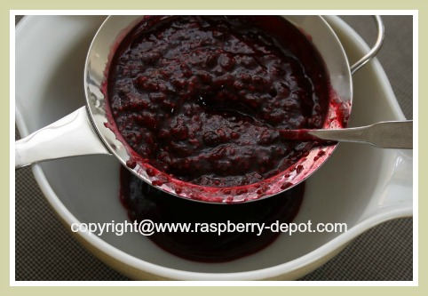 Removing the Raspberry Seeds to Make Seedless Raspberry Syrup